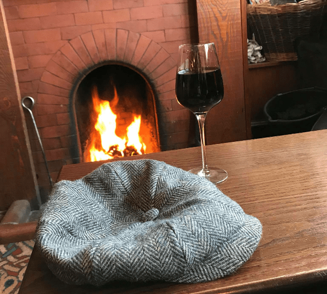 open fire glass of wine